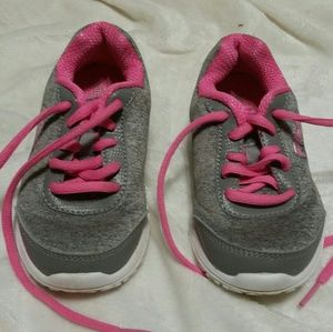 Fila pink and grey tennis shoes.